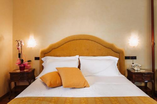 Letto o letti in una camera di Grand Hotel Excelsior