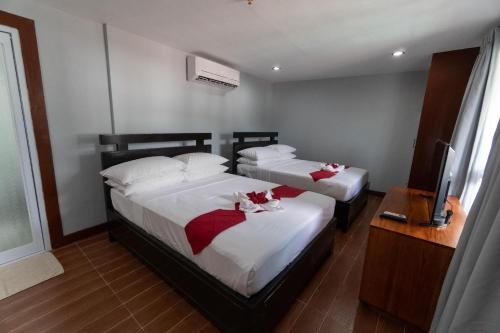 A bed or beds in a room at One Averee Bay Hotel
