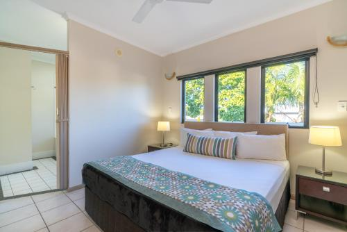 A bed or beds in a room at Regal Port Douglas