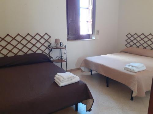 Letto o letti in una camera di Faraglioni house
