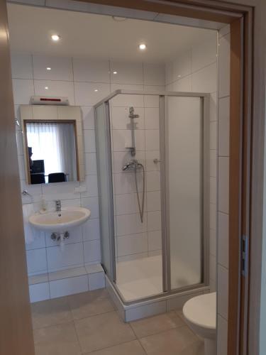 Ein Badezimmer in der Unterkunft Simon-Dach-Haus