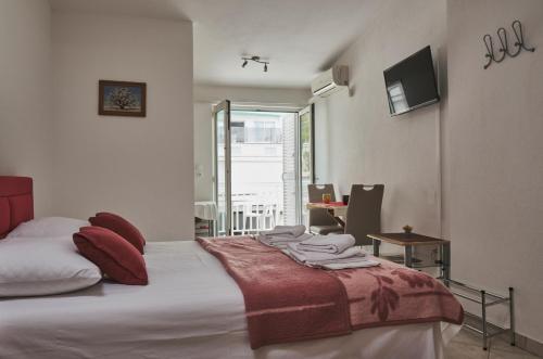 Postel nebo postele na pokoji v ubytování Studios Ruža