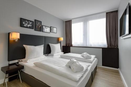 Ein Bett oder Betten in einem Zimmer der Unterkunft Mercure Hotel Potsdam City