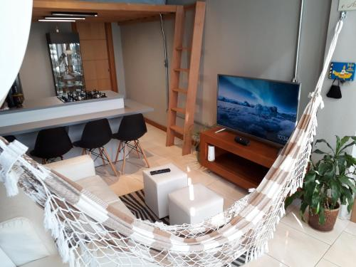 A television and/or entertainment centre at Loft, conforto e praticidade.