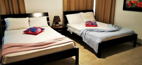 A bed or beds in a room at Apartment Ocean Front Infiniti Blu