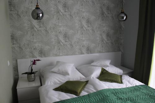 Łóżko lub łóżka w pokoju w obiekcie Apartamenty Jagiellońska 23