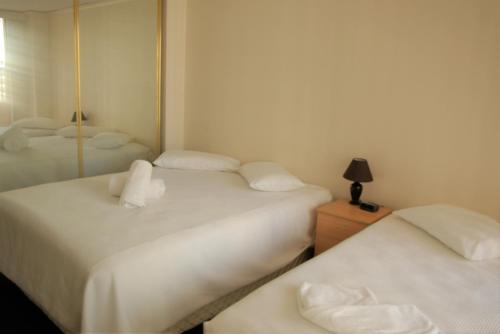 A bed or beds in a room at Accommodation Sydney - Kent Street