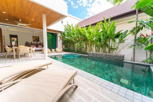Бассейн в Rawai Ka 4-Bedroom Villa или поблизости