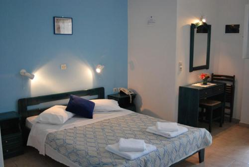 A bed or beds in a room at Aigaio Rooms