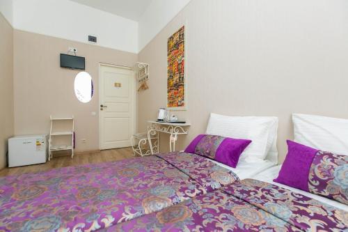 Кровать или кровати в номере Soft Pillow