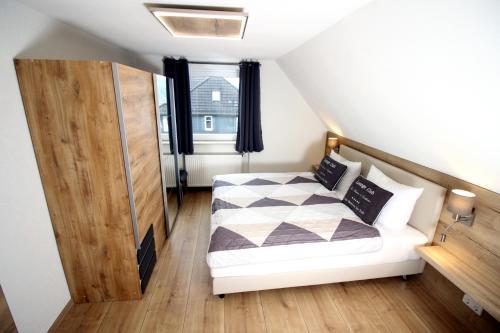 Ein Bett oder Betten in einem Zimmer der Unterkunft Germina Apart