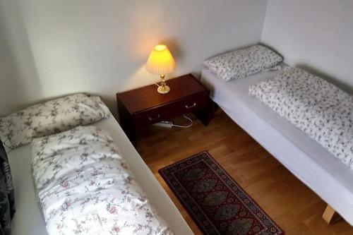 Posteľ alebo postele v izbe v ubytovaní Lofoten Apartment + Rooms - Skrova