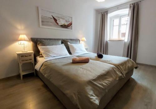 Un ou plusieurs lits dans un hébergement de l'établissement nona Marta apartment