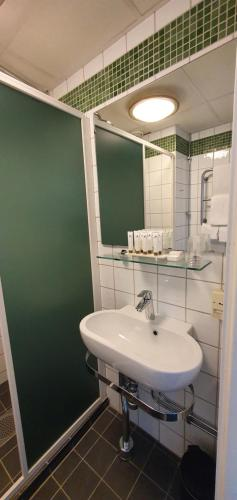A bathroom at Hotel Garden