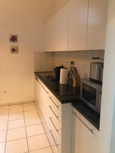 A kitchen or kitchenette at Messe Appartements Essen
