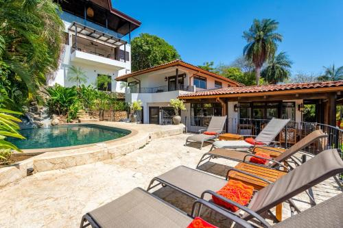 The swimming pool at or near Luxury 4-bedroom home a short walk from the beach