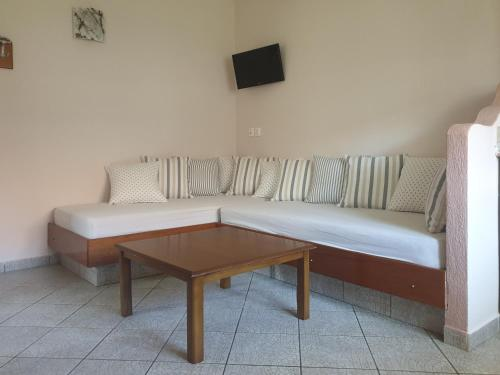 A seating area at Ammos Kalamitsi