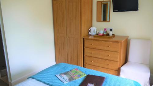 A bed or beds in a room at Gable Lodge Guest House