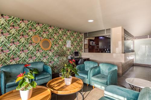 Een zitgedeelte bij TC Apartamentos Rocamar