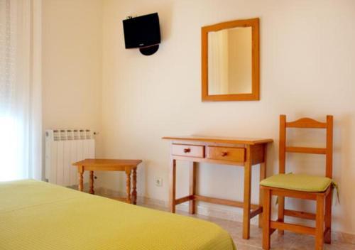 Cama o camas de una habitación en Hotel Casa Portuguesa