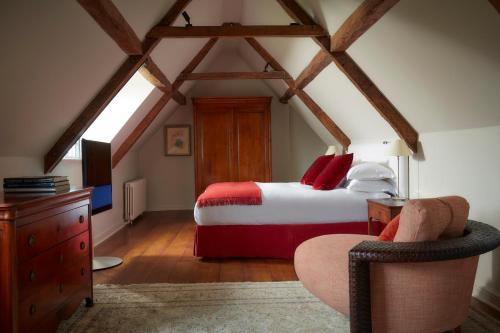 A bed or beds in a room at Whatley Manor