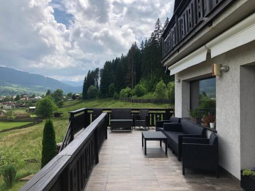 A balcony or terrace at Bucovina Lodge Pension