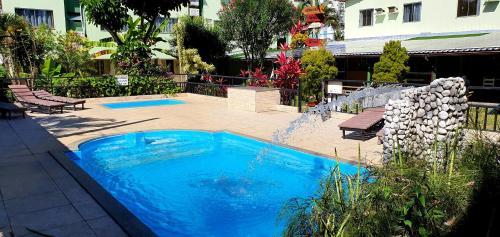 The swimming pool at or near Duas Praias Hotel Pousada