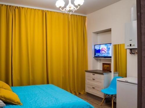 Телевизор и/или развлекательный центр в  La Casa Di Bury Apartments 2