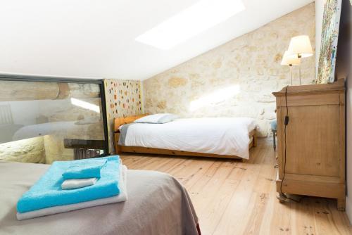 Un ou plusieurs lits dans un hébergement de l'établissement Le Pain de Lune Gîte et Chambre d'hôtes avec Piscine