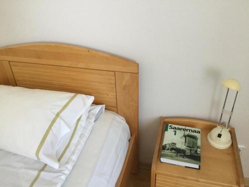Voodi või voodid majutusasutuse Kuressaare Tallinn Street Apartments toas