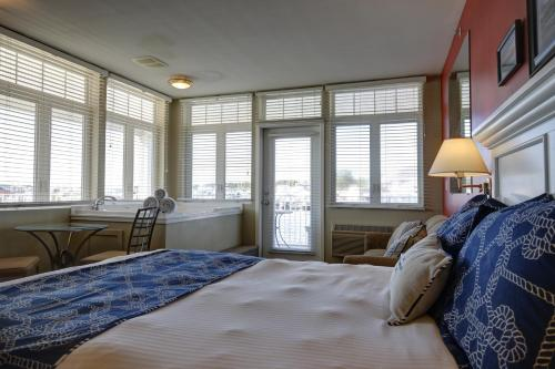 A bed or beds in a room at Weathervane Inn
