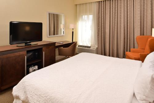 A bed or beds in a room at Hampton Inn South Hill