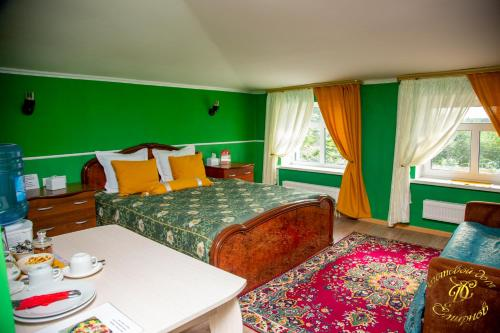 A bed or beds in a room at Smirnov Hotel
