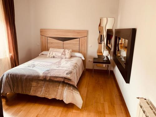A bed or beds in a room at Estudios Blanmart