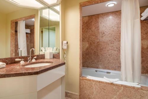 A bathroom at The Buckingham Hotel