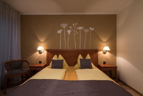 Letto o letti in una camera di Hotel Residence Martha