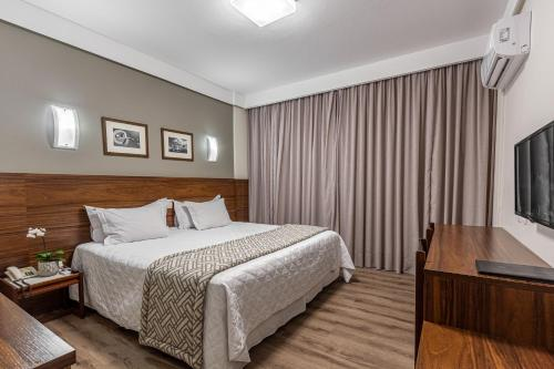 A bed or beds in a room at Hotel Bahia do Sol