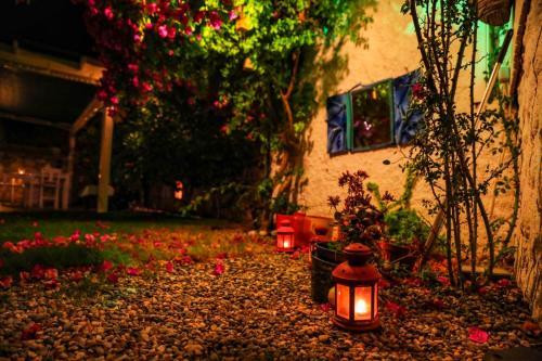 A garden outside Sari Gelin Alacati Hotel