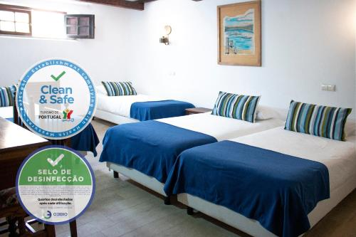 A bed or beds in a room at Rainha Santa Isabel - Óbidos History Hotel