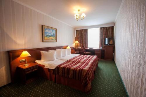 Кровать или кровати в номере Корстон Клуб Отель Москва