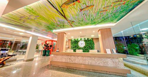 The lobby or reception area at Amazon Plaza Hotel