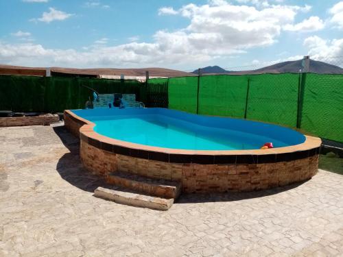 Bazén v ubytování Magica Tindaya surf house nebo v jeho okolí
