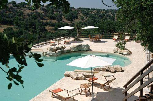 A view of the pool at Relais Parco Cavalonga or nearby