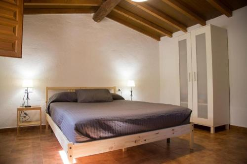 A bed or beds in a room at Complejo Roma