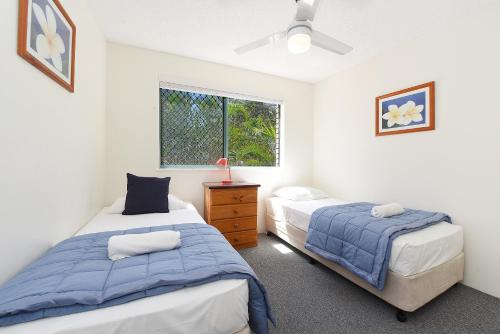 A bed or beds in a room at Lindomare Apartments