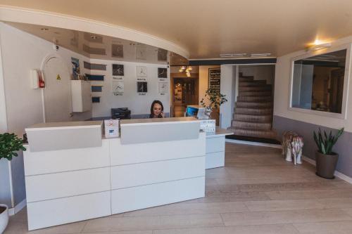 Лобби или стойка регистрации в Hotel Restaurant & Spa L'Ostella