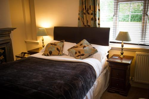 A bed or beds in a room at Claverton Hotel