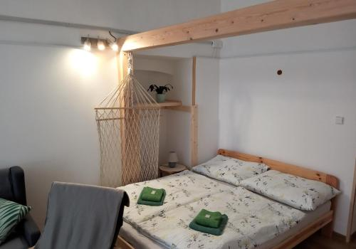 A bed or beds in a room at Apartment pod hradem Loket