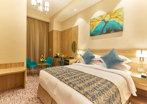 A bed or beds in a room at Rose Plaza Hotel Al Barsha