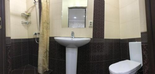 A bathroom at Гостевой дом ,,Радуга""